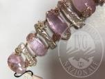 Immagine di Rif 2/2 bracciale oro giallo 18 kt con perle di acqua dolce zaffiri rosa e diamantidiamanti taglio brillante peso ct 0-70- zaffiri rosa peso ct 2-97le gemme sono incassate in una montatura del peso di 52 gr valore del gioiello