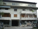 Immagine di Opificio artigianale, uffici, residenza in condominio e terreni.