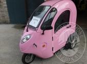 Triciclo elettrico con cabina chiusa, colore rosa